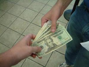 Someone handing over money