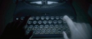 Alan Wake working on his typewriter in first person view.