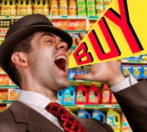 """A salesman yelling, """"Buy!"""""""