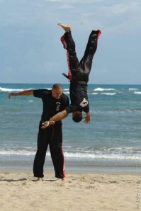 A man in the air after a brazilian jujitsu throw.