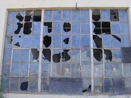 A lot of broken window panes.