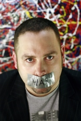 Paul Barnett, with tape over his mouth.