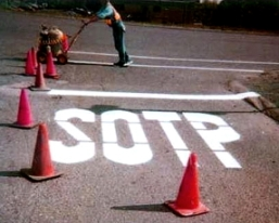 The word 'Stop' has been painted at a stop sign as S-O-T-P.