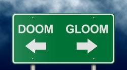 A sign showing the directions to doom and gloom.