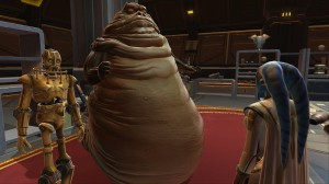 A picture of a Hutt with assistant robot talking to a Twi'lek.