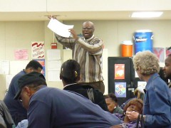 Attempts to explain the process during the Democratic Precinct 208 Convention (Caucus): Man holding up paper to a crowd - http://www.flickr.com/photos/abbamouse/2312342504/
