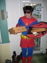 Someone in a pseudo Superman suit delivering pizzas.