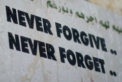 "A sign saying, ""Never forgive, never forget""."