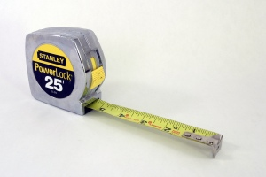 A tape measure. For measuring things. From: http://upload.wikimedia.org/wikipedia/commons/d/d9/Stanley_PowerLock_tape_measure.jpg