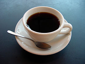 A small cup of hot coffee.