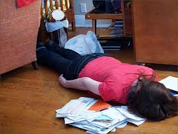 A girl lying face down in a pile of mail.