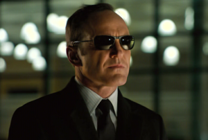 A picture of Agent Coulson with glasses on.