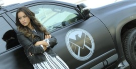 Skye leaning up against a car with SHIELD logo on the door. Later on this episode it is used in a car chase with a hacker.