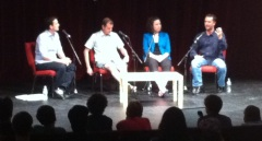 A blurry picture of four people on a stage.