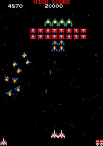 A picture of Galaga being played.