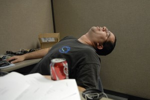 A man asleep at his desk.