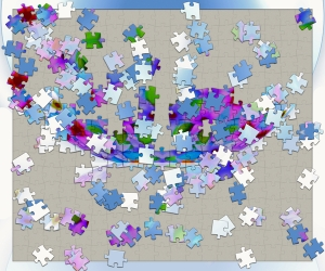 A picture of an unfinished jigsaw puzzle; the pieces are multiple colours