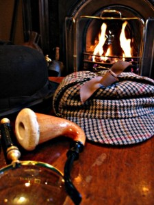 A pipe, stove hat and general Englishness.