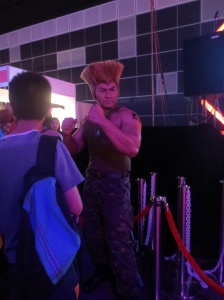 It's a Guile cosplay. There's a 50% chance that was his real hair.